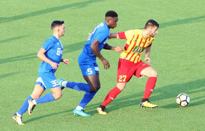 Luke Montebello of Birkirkara trying to hold on to the ball while being pressed by Ebiabowei Baker. Photo: Dominic Borg