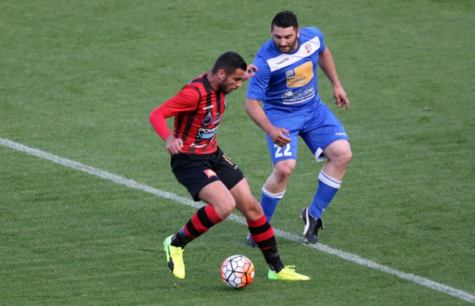 Jake Grech (Ħamrun) and Tyrone Farrugia (Mosta) in action. Photo: Dominic Borg