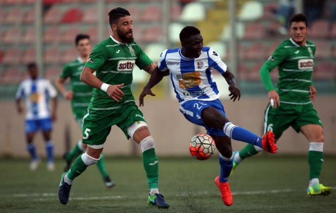 Enrico Pepe of Floriana challenging Lucky Victor Oseghale for the ball. Photo: Dominic Borg