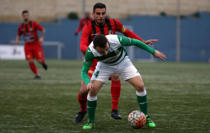 Jake Grech of Ħamrun challenging Ryan Camenzuli for the ball. Photo: Dominic Borg