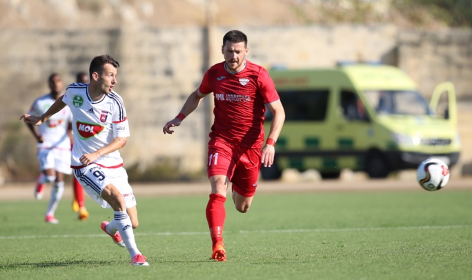Steve Bezzina (Balzan) and Asmir Sulijic (Videoton) in action. Photo: Christine Borg