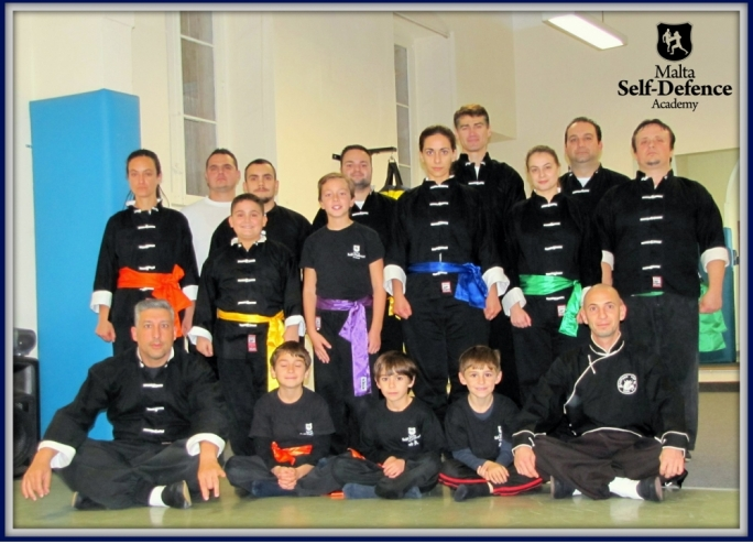 Successful students with their instructor, Sifu Mark (sitting on the left)