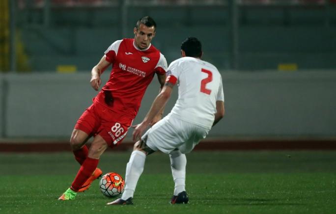 Bojan Kaljevic of Balzan trying to go past Jonathan Caruana. Photo: Dominic Borg