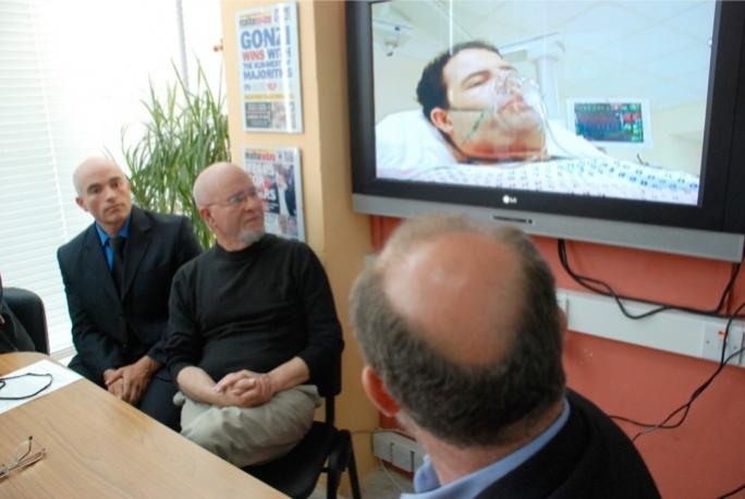 Joe Azzopardi (centre) listening to his son Nicholas's last words