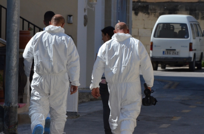 Forensic officers at the Scene of the crime