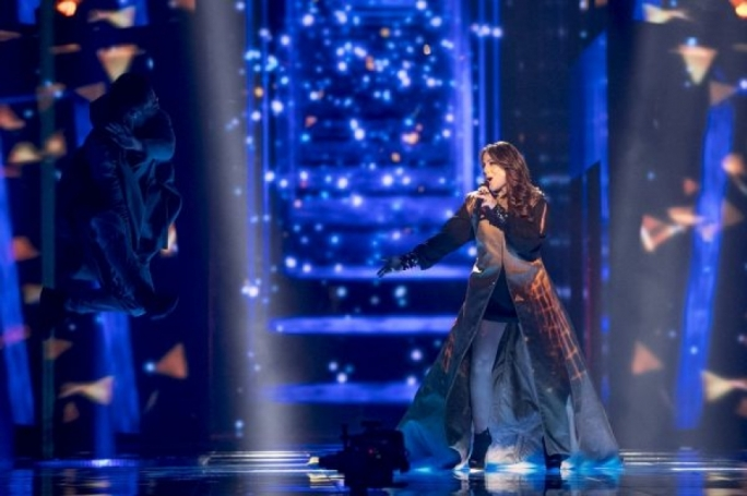 Ira Losco's high-tech projection coat was ditched for a more glamorous dress