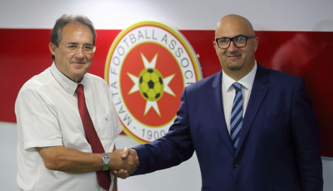 Norman Darmanin Demajo (left) congratulating Ivan Vella on his new appointment as director of national teams