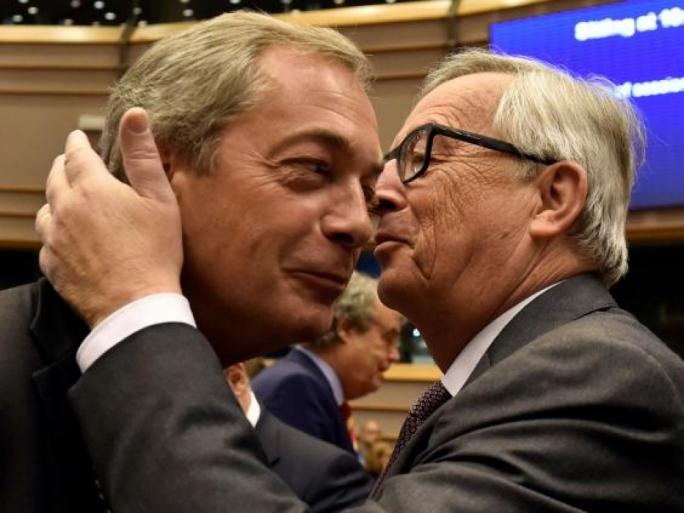 The last kiss goodbye: MEP Nigel Farage (left) and Jean-Claude Juncker crossed swords again in a debate on the start of Brexit negotiations