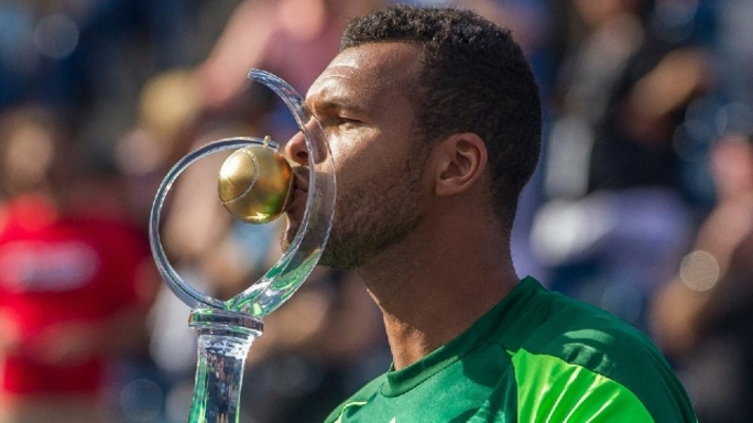 Jo-Wilfried Tsonga kisses the Rogers Cup after defeating Roger Federer of Switzerland 7-5, 7-6 in the final of the Rogers Cup at Rexall Centre in Toronto