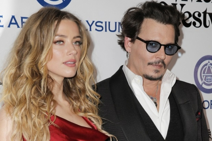 Johnny Depp has been ordered to stay away from his estranged wife, Amber Heard