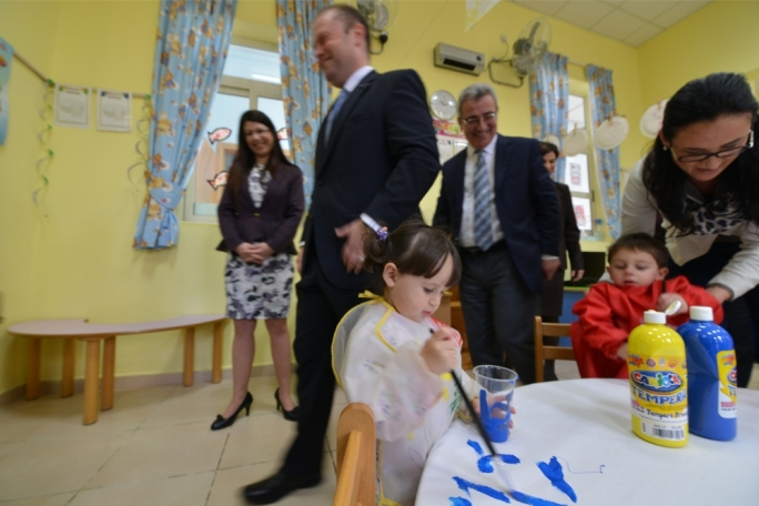 Prime Minister Joseph Muscat visiting a childcare centre at the Qormi primary school in 2014