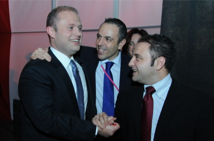 Prime Minister Joseph Muscat insisted he has no obligations towards his chief of staff Keith Schembri (centre)