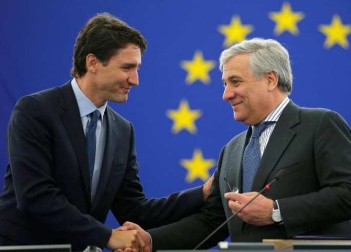 Canada's Prime Minister Justin Trudeau (L) arrives with European Parliament President Antonio Tajani to address the European Parliament in Strasbourg, France