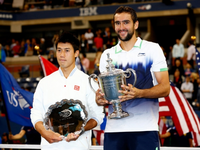 Kei Nishikori and Marin Cilic of Croatia pose with trophies at the US Open