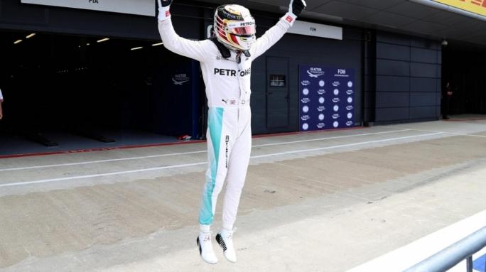 Pole sitter Lewis Hamilton (GBR) Mercedes AMG F1 celebrates in parc ferme at Formula One World Championship, Rd10, British Grand Prix, Qualifying, Silverstone, England