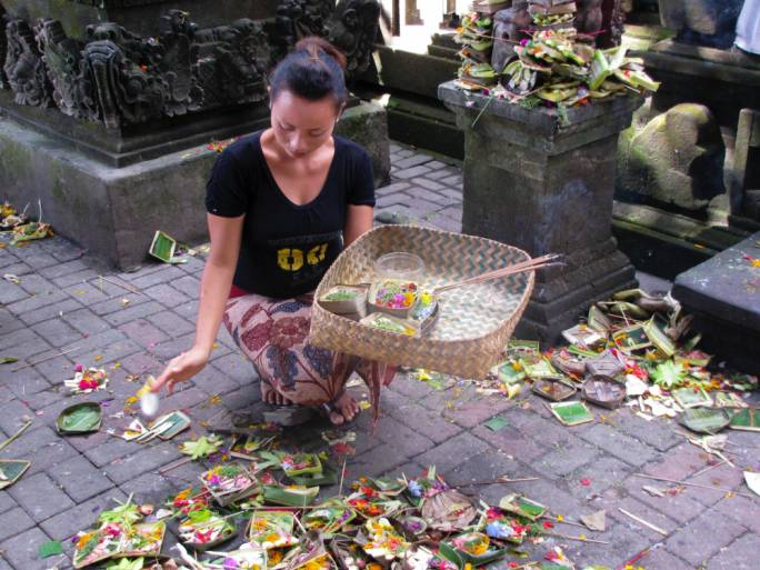 The local Balinese women create offerings to the gods that can be found all over the city
