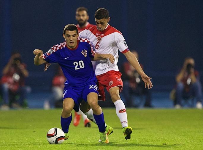 Croatia's Mateo Kovacic keeps the ball away from Malta's Ryan Fenech. Photo by Paul Zammit Cutajar / MFA