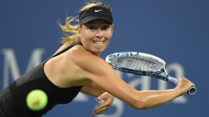 Maria Sharapova returns to Maria Kirilenko in the first round of the US Open