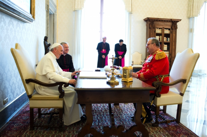 Pope Francis grants an audience to Fra' Matthew Festing, the 79th prince and grand master of the Sovereign Military Order of Malta