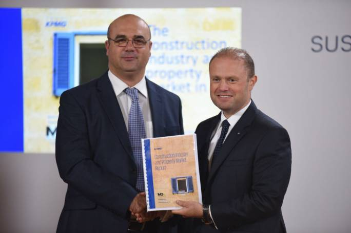 MDA president Sandro Chetchuti presenting a copy of the study to Prime Minister Joseph Muscat. (Photo: James Bianchi/MediaToday)