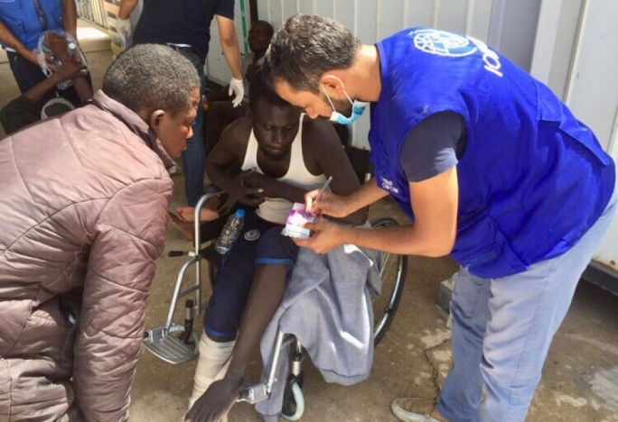 Rescued migrants being treated by IOM staff in Tripoli (Photo: IOM)
