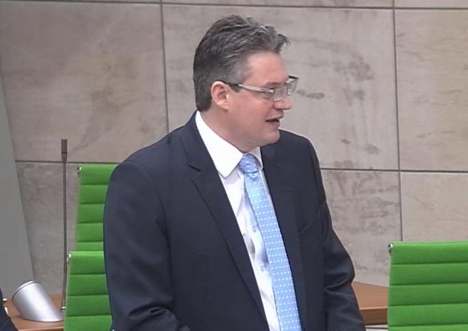 Minister Konrad Mizzi delivers a speech in Parliament