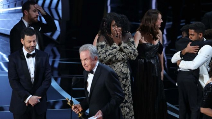Cast and crew of Moonlight react after they learn it has won best picture. as Warren Beatty explains the error