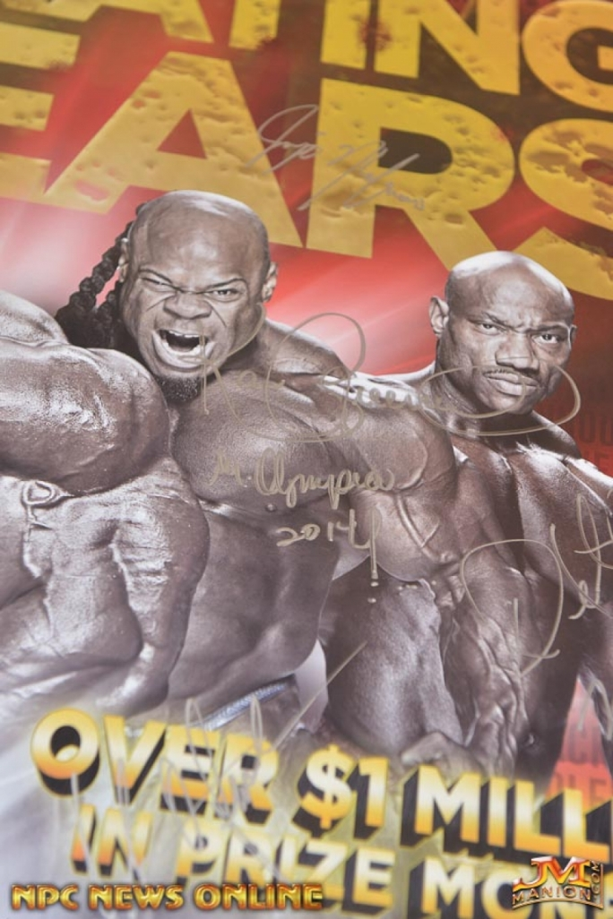 Kai Greene's signature on the 2014 Mr. Olympia poster