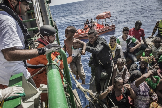 Charity row over Italian migrant rescue rules