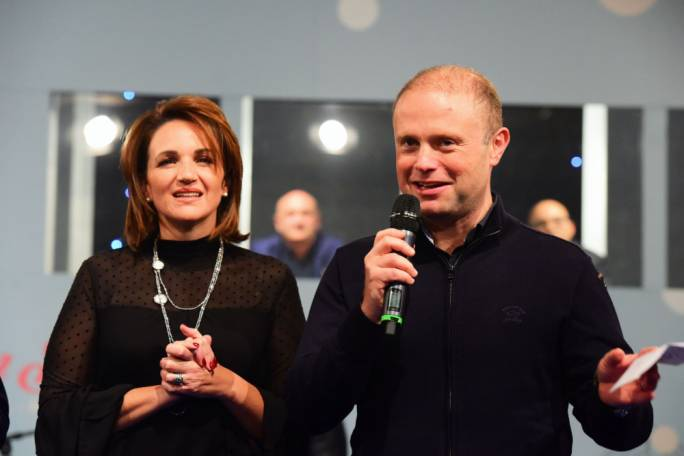 Joseph Muscat and wife Michelle, announcing the sum collected by the Labour Party in its fund raising telethon