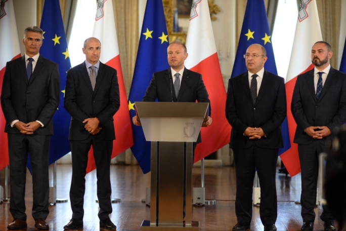 Maltese Prime Minister Joseph Muscat flanked by senior government ministers addressing a press conference at Auberge de Castille on the Lifeline crisis