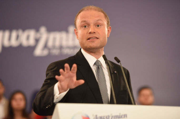 Prime Minister Joseph Muscat addressing a public meeting in Qawra. Photo: James Bianchi/MediaToday