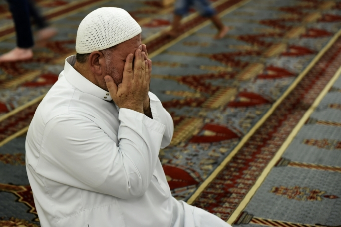 A man prays at the end of the Ramadan fast at the Paola mosque