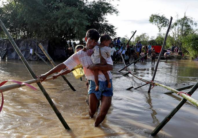 Rohingya cross a river at a refugee camp in Cox's Bazar, in Bangladesh (Photo: Asia Times)