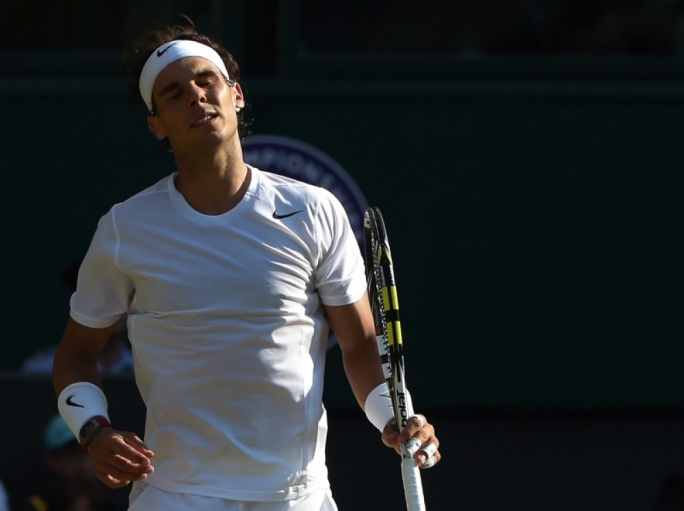 Rafael Nadal of Spain facing defeat by Nick Kyrgios of Australia in their fourth round match during the Wimbledon Championships. Photo by EPA/FACUNDO ARRIZABALAGA