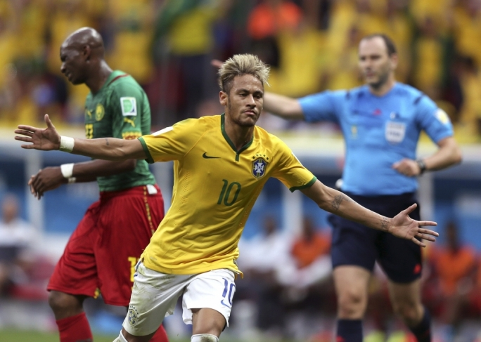Neymar of Brazil celebrates after scoring a goal during the FIFA World Cup 2014 group A preliminary round match between Cameroon and Brazil at the Estadio Nacional in Brasilia  EPA/MARCELO SAYAO