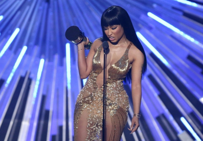 Nicki Minaj bites back at host Miley Cyrus after accepting her award for best hip hop video