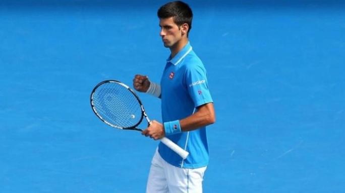 Novak Djokovic celebrates victory in Australian Open first round