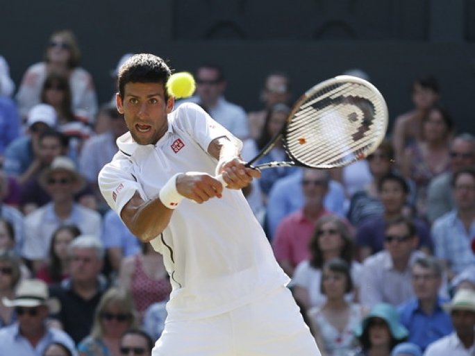 Novak Djokovic of Serbia returns to Andy Murray of Britain during the men's Wimbledon final on July 7, 2013. Djokovic pulled out of an exhibition game Thursday ahead of Monday's start to the 2014 championships. Photo by: EPA/KERIM OKTEN