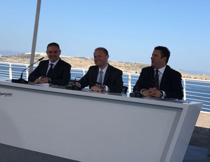 Prime Minister and Labour Party leader Joseph Muscat addresses a press conference with justice minister Owen Bonnici and tourism minister Edward Zammit Lewis