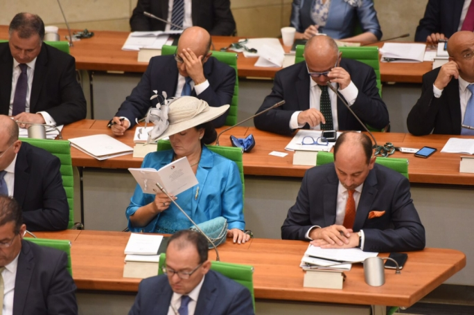 Godfrey Farrugia of the PN list with a PD badge said that a unifying gesture by Muscat could be brought about by amending the public administration act