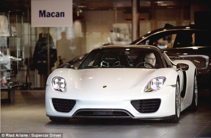 Paul Bailey, pictured in his white Porsche 918, was behind the wheel of the car