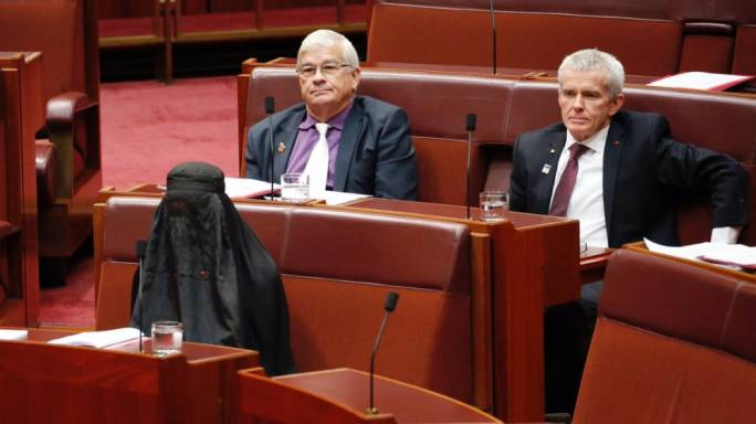 One Nation Leader Pauline Hanson wearing a burqa in the Senate chamber at Parliament House in Canberra