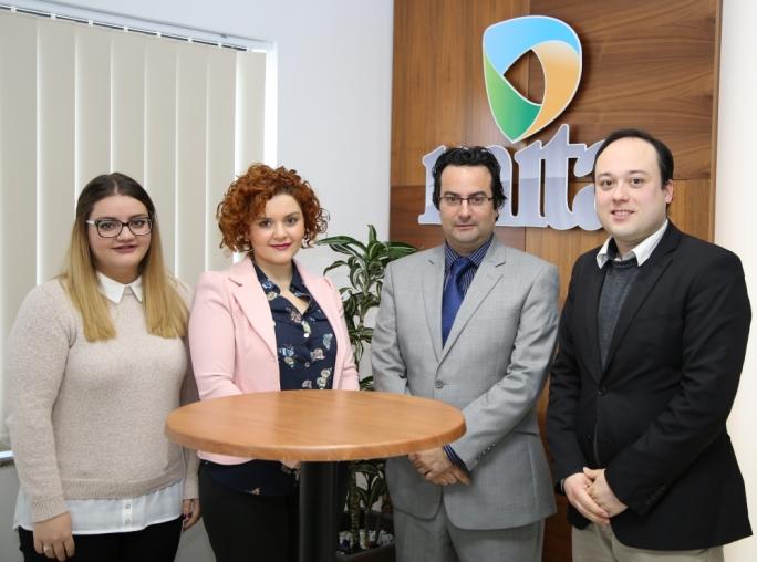 Student Andrea Mallia with Daniela Chetcuti, Prof Frank Zammit and Dr Vincent-Anthony Marmara