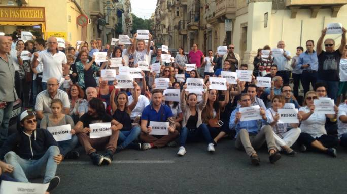 Crowd block street in front of Floriana Police HQ calling on police commissioner to resign
