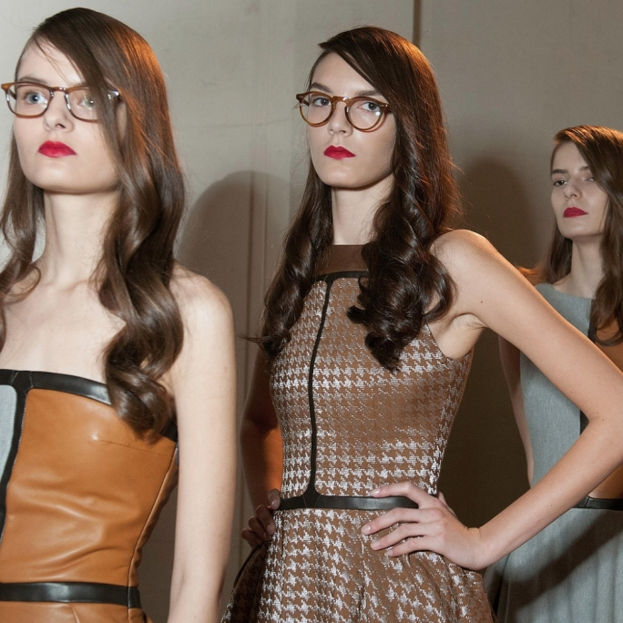 Two models from the 2015 Haute Couture Fashion Week show how glasses can complete a look for Didit Hediprasetyo