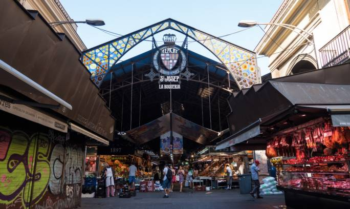 The market La Boqueria is jam packed with permanent stalls selling fresh fruit and veg, cold meats, cheeses, olive oils and fish and also has plenty of spots to indulge in tapas and cold beers