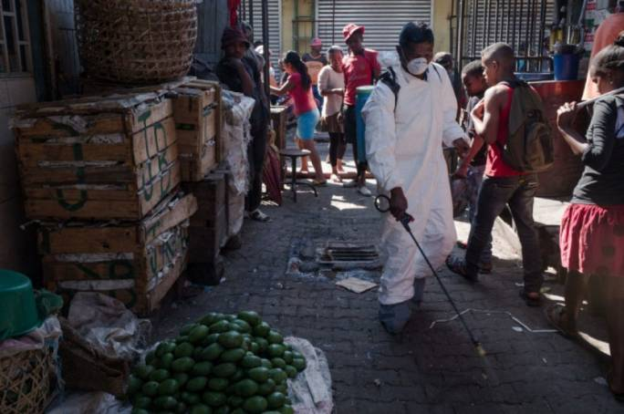 A council worker sprays disinfectant in the city of Antananarivo, Madagascar (Photo: The Toronto Star)