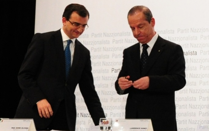 Prime Minister Lawrence Gonzi (R) with PN secretary general Paul Borg Olivier
