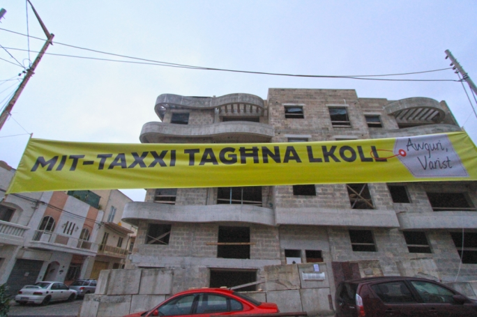 The PN unfurled a banner over the Rabat property at the centre of police investigations into the FTS scandal
